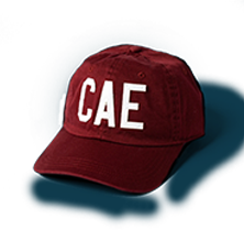 Letters 'CAE' on maroon baseball cap